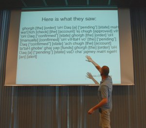 Photo of Gojko Adzic demonstrating communication gaps in his keynote presentation at Agile Testing Days 2009
