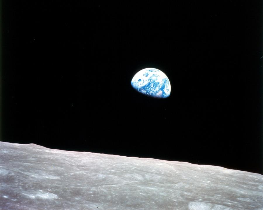 This image changed the world. It was taken from Apollo 9 in 1968 and shows the blue Earth rise over the grey and deserted Moon. Our world seems fragile.